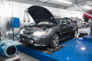 Black Gray STI sedan getting tuned on Mustang AWD 4WD Dyno Dynamometer