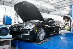 Black BMW on Mustang AWD 4WD Dyno Dynamometer