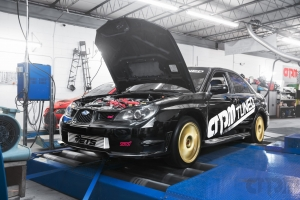 Black Subaru STI Hawkeye Track car Shop Car on Mustang AWD 4WD Dyno Dynamometer