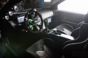 Interior of 240sx Drift car with gauges and custom installed monitors