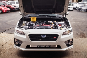 Subaru STi 2015 WRX Front Engine Bay shot infront of our villa park location