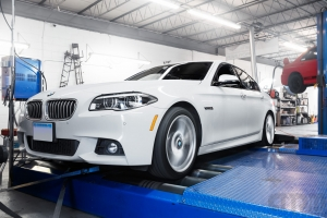 White BMW on Mustang AWD 4WD Dyno Dynamometer