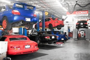 Shot of Shop with two vipers, one subaru sti and two mitsubishi evo 9