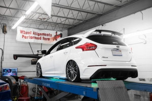 Ford Focus RS On alignment rack with air suspension bags and underglow