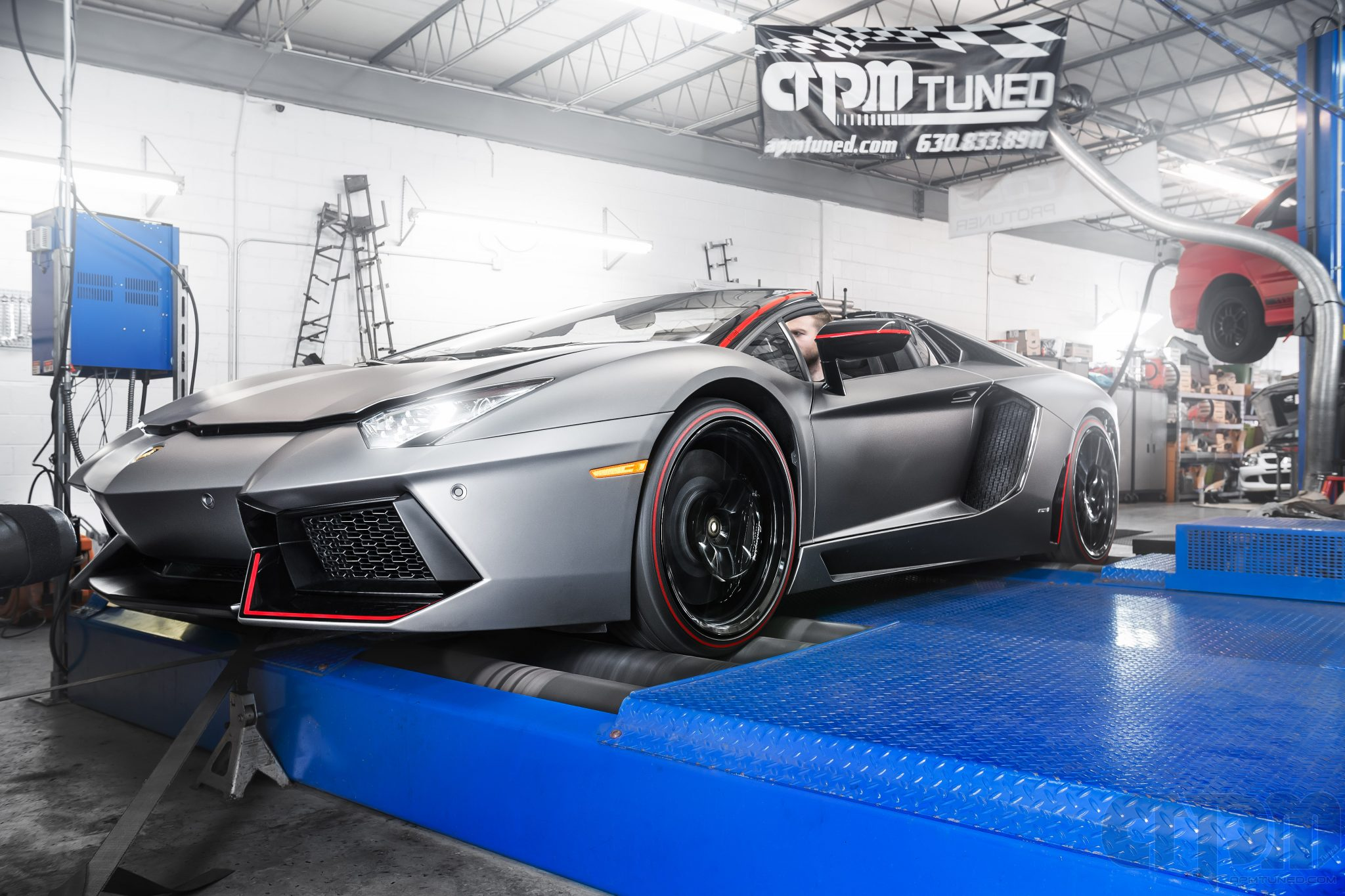 Front shot of a Lamborghini 2016 Aventador LP700 getting tuned on our Mustang AWD 4WD Dynamometer Dyno